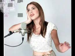 la amamos por cantar bien
